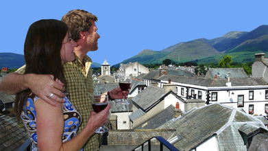 Couple enjoying glass of wine on balcony of The Penthouse at The Views